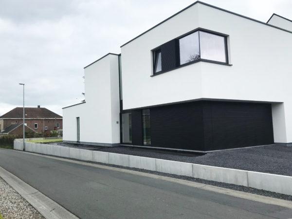 Nieuwbouwwoning met strakke gevel bepleistering Tony Boel